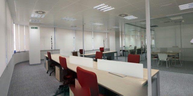 empleados vuelven a las oficinas de AXA